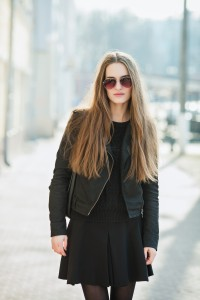 City portrait of young beautiful fashionable woman in sunglasses